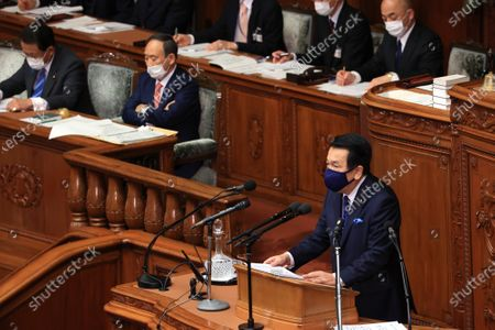 Japanese main opposition Constitutional Democratic Party of Japan leader Yukio Edano (R) questions to Prime Minister Yoshihide Suga (C) at Lower House's plenary session at the National Diet in Tokyo on Wednesday, January 20, 2021. Ruling and opposition parties questioned to Suga as Suga delivered his policy speech at the beginning of an ordinary Diet session on January 18.
