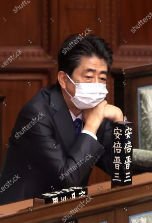 Stock Photo of Former Japanese Prime Minister Shinzo Abe attends Lower House's plenary session at the National Diet in Tokyo on Wednesday, January 20, 2021. Ruling and opposition parties questioned to Prime Minister Yoshihide Suga as Suga delivered his policy speech at the beginning of an ordinary Diet session on January 18.