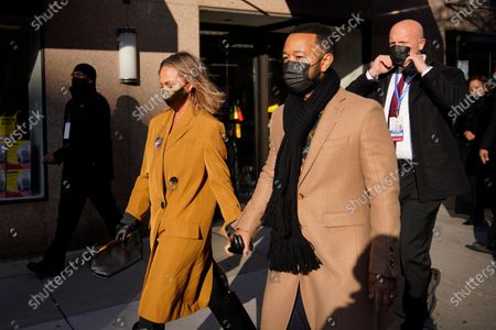 Chrissy Teigen and John Legend leave their hotel during 59th Presidential Inauguration, in Washington
