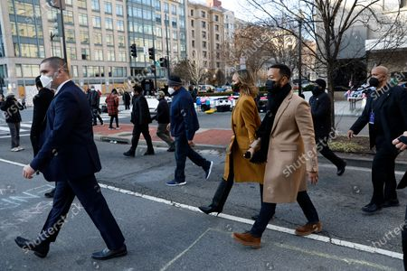 Chrissy Teigen and John Legend leave their hotel with security guards during 59th Presidential Inauguration, in Washington