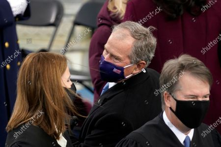 Former President George W. Bush talks with Supreme Court Justice Amy Coney Barrett and Justice Brett Kavanaugh, walks past, as theyarrive for the 59th Presidential Inauguration at the U.S. Capitol for President-elect Joe Biden in Washington