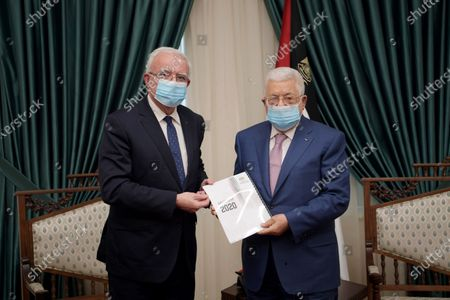 Editorial photo of Palestinian President Mahmoud Abbas, receives the annual report of the Ministry of Foreign Affairs from Dr. Riyad Al-Maliki, Ramallah, West Bank, Palestinian Territory - 20 Jan 2021