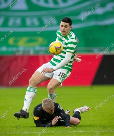 Tom Rogic of Celtic & Craig Sibbald of Livingston during the Scottish Premiership match between Celtic & Livingston at Celtic Park, Glasgow on 16 January 2021.