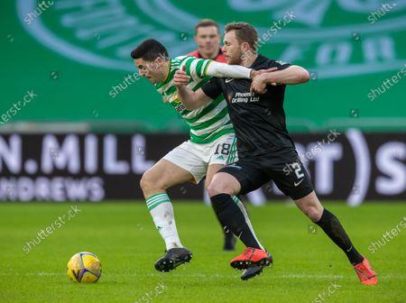Tom Rogic of Celtic & Nicky Devlin of Livingston during the Scottish Premiership match between Celtic & Livingston at Celtic Park, Glasgow on 16 January 2021.