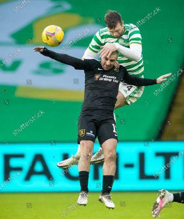 Stock Image of Shane Duffy of Celtic & Scott Robinson of Livingston during the Scottish Premiership match between Celtic & Livingston at Celtic Park, Glasgow on 16 January 2021.