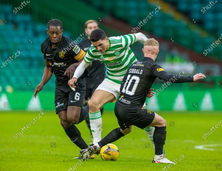 Tom Rogic of Celtic between Marvin Bartley & Craig Sibbald of Livingston during the Scottish Premiership match between Celtic & Livingston at Celtic Park, Glasgow on 16 January 2021.