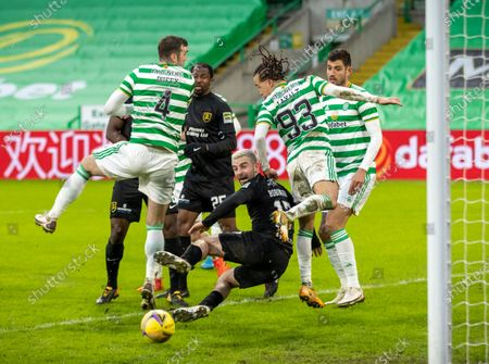 Scott Robinson of Livingston goes down inside the penalty area between Shane Duffy & Diego Laxalt of Celtic during the Scottish Premiership match between Celtic & Livingston at Celtic Park, Glasgow on 16 January 2021.