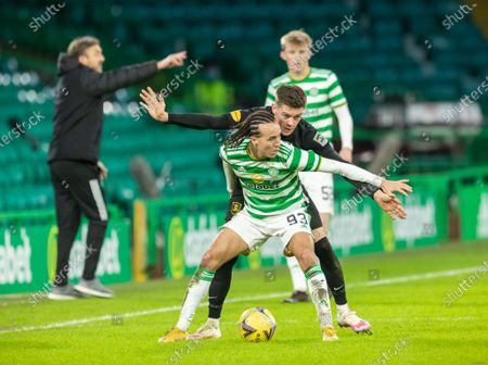 Diego Laxalt of Celtic under pressure from Josh Mullin of Livingston during the Scottish Premiership match between Celtic & Livingston at Celtic Park, Glasgow on 16 January 2021.