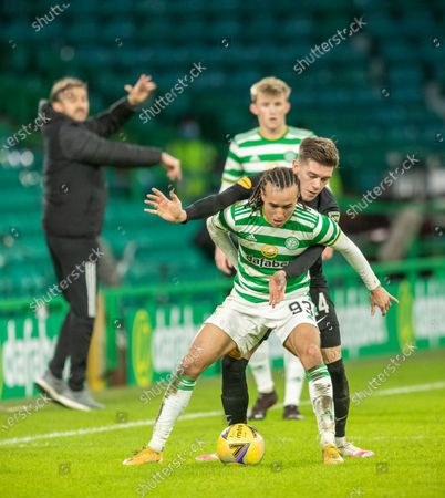 Stock Picture of Diego Laxalt of Celtic under pressure from Josh Mullin of Livingston, watched by Celtic's stand-in Manager Gavin Strachan, during the Scottish Premiership match between Celtic & Livingston at Celtic Park, Glasgow on 16 January 2021.