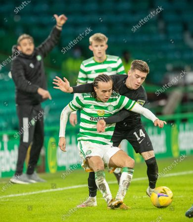 Diego Laxalt of Celtic under pressure from Josh Mullin of Livingston, watched by Celtic's stand-in Manager Gavin Strachan, during the Scottish Premiership match between Celtic & Livingston at Celtic Park, Glasgow on 16 January 2021.