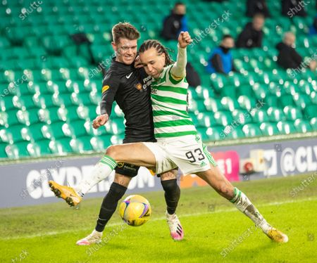 Josh Mullin of Livingston battles with Diego Laxalt of Celtic during the Scottish Premiership match between Celtic & Livingston at Celtic Park, Glasgow on 16 January 2021.