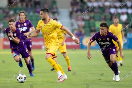 Tomi Juric of Adelaide United controls the ball