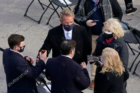 Former Sen. Jeff Flake, R-Ariz. arrives for the 59th Presidential Inauguration at the U.S. Capitol in Washington