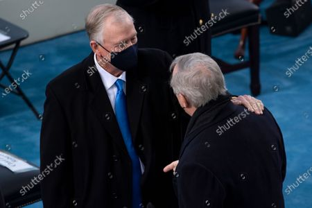 UNITED STATES - January 20: Former United States Vice President Dan Quayle talks with US Senate Minority Whip Dick Durbin (Democrat of Illinois), as he arrives to the West Front of the U.S. Capitol for the Inauguration of Joe Biden in Washington.