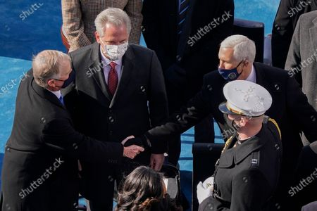 Former Vice President Dan Quayle, left, shakes hands with former Vice President Mike Pence, right, as House Minority Leader Kevin McCarthy of Calif., center, looks on after attending the 59th Presidential Inauguration at the U.S. Capitol in Washington