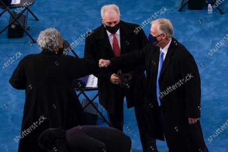 Former Democratic National Committee Chairwoman Donna Brazile, left, greeting former Vice President Dan Quayle, right, as House Minority Whip Steve Scalise, R-La., center, looks on as they arrive at the 59th Presidential Inauguration at the U.S. Capitol in Washington, . Brazile was invited to the inauguration as Scalise's guest