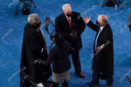 Former Democratic National Committee Chairwoman Donna Brazile (L) talking with former Vice President Dan Quayle (R) and House Minority Whip Steve Scalise, R-La., (C) as they arrive for the inauguration of Joe Biden as US President in Washington, DC, USA, 20 January 2021. Biden won the 03 November 2020 election to become the 46th President of the United States of America.