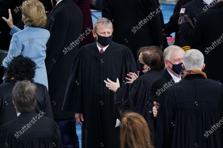 Chief Justice John G. Roberts arrive for the inauguration of Joe Biden as US President in Washington, DC, USA, 20 January 2021. Biden won the 03 November 2020 election to become the 46th President of the United States of America.