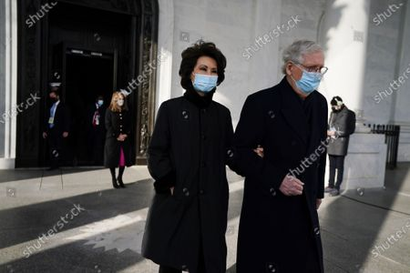 Senate Majority Leader Mitch McConnell, right, and his wife, former Secretary of Transportation Elaine Chao arrive for the inauguration of Joe Biden as US President in Washington, DC, USA, 20 January 2021. Biden won the 03 November 2020 election to become the 46th President of the United States of America.