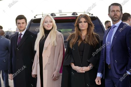 Tiffany Trump and her fiancé Michael Boulos, left, and Donald Trump Jr., and his girlfriend Kimberly Guilfoyle, wait for President Donald Trump and First Lady Melania Trump to arrive and board Air Force One for a final time at Andrews Air Force Base, Md