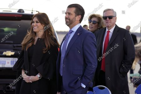Donald Trump Jr., and his girlfriend Kimberly Guilfoyle, and White House chief of staff Mark Meadows wait for President Donald Trump and First Lady Melania Trump to arrive and board Air Force One for a final time at Andrews Air Force Base, Md