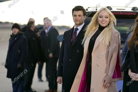 Tiffany Trump and her fiancé Michael Boulos, wait for President Donald Trump and First Lady Melania Trump to arrive and board Air Force One for a final time at Andrews Air Force Base, Md