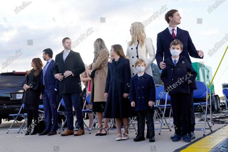 Stock Image of From left, Donald Trump Jr., and his girlfriend Kimberly Guilfoyle, Eric Trump and his wife Lara Trump and their children and Ivanka Trump and her husband Jared Kushner and their children Theodore, Joseph and Arabella wait for President Donald Trump to arrive at Andrews Air Force Base, Md