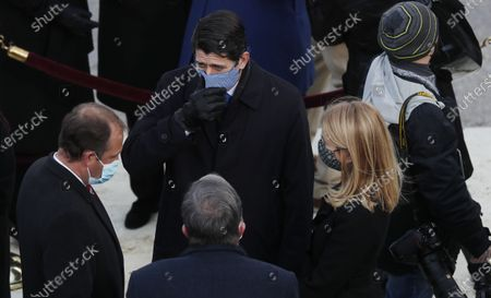 Stock Photo of Former Speaker of the House Paul Ryan (2L) arrives prior to the inaugural ceremony for President-elect Joe Biden and Vice President-elect Kamala Harris on the West Front of the U.S. Capitol in Washington, DC, USA, 20 January 2021. Biden won the 03 November 2020 election to become the 46th President of the United States of America.