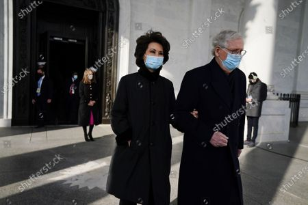 Senate Majority Leader Mitch McConnell, right, and his wife, former Secretary of Transportation Elaine Chao, arrive at the U.S. Capitol ahead of the 59th Presidential Inauguration in Washington, . Joe Biden was sworn in as the 46th president of the U.S