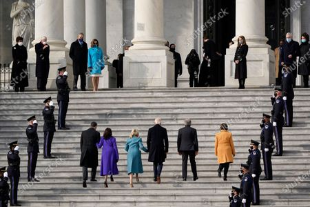 President-elect Joe Biden, his wife Jill Biden and Vice President-elect Kamala Harris and her husband Doug Emhoff arrive at the steps of the U.S. Capitol for the start of the official inauguration ceremonies, in Washington, . Speaker of the House, Nancy Pelosi waits at left and Senate Majority Leader Mitch McConnell and his wife, former Secretary of Transportation Elaine Chao wait I at top right