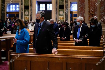 House Speaker Nancy Pelosi and her husband Paul Pelosi and Senate Minority Leader Mitch McConnell and his wife Elaine Chao attend Mass at the Cathedral of St. Matthew the Apostle during Inauguration Day ceremonies, in Washington