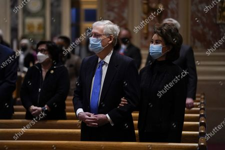 Senate Minority Leader Mitch McConnell and his wife Elaine Chao attend Mass at the Cathedral of St. Matthew the Apostle during Inauguration Day ceremonies, in Washington