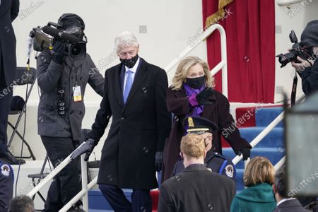 Former United States President Bill Clinton and former US Secretary of State Hillary Rodham Clinton arrive prior to US President Joe Biden taking the Oath of Office as the 46th President of the US at the US Capitol in Washington, DC.