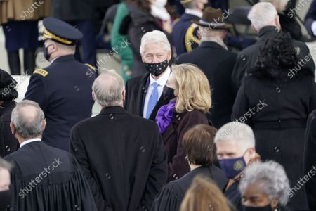 Former United States President Bill Clinton and former US Secretary of State Hillary Rodham Clinton prior to Joe Biden taking the Oath of Office as the 46th President of the US at the US Capitol in Washington, DC.