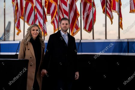 Eric Trump, executive vice president of Trump Organization Inc., right, and his wife Lara Trump, arrive to a farewell ceremony at Joint Base Andrews, Maryland, U.S.,. Trump departs Washington with Americans more politically divided and more likely to be out of work than when he arrived, while awaiting trial for his second impeachment - an ignominious end to one of the most turbulent presidencies in American history.