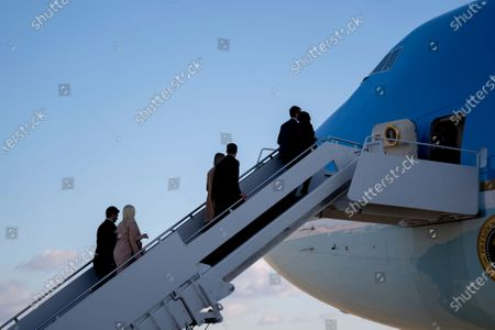 First children Donald Trump Jr., Eric Trump, and Tiffany Trump, along with their partners, board Air Force One during a farewell ceremony at Joint Base Andrews, Maryland, U.S.,. Trump departs Washington with Americans more politically divided and more likely to be out of work than when he arrived, while awaiting trial for his second impeachment - an ignominious end to one of the most turbulent presidencies in American history.