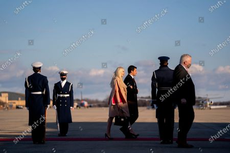 First daughter Tiffany Trump, third from left, walks to board Air Force One during a farewell ceremony at Joint Base Andrews, Maryland, U.S.,. Trump departs Washington with Americans more politically divided and more likely to be out of work than when he arrived, while awaiting trial for his second impeachment - an ignominious end to one of the most turbulent presidencies in American history.
