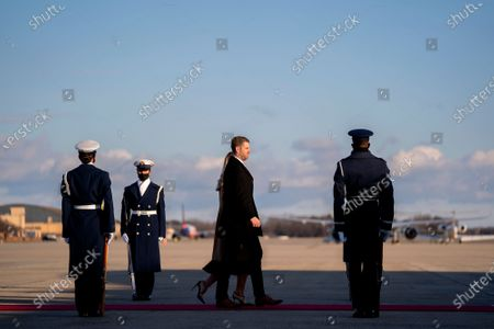 First son Eric Trump, center, and his wife Lara Trump, walk to board Air Force One during a farewell ceremony at Joint Base Andrews, Maryland, U.S.,. Trump departs Washington with Americans more politically divided and more likely to be out of work than when he arrived, while awaiting trial for his second impeachment - an ignominious end to one of the most turbulent presidencies in American history.