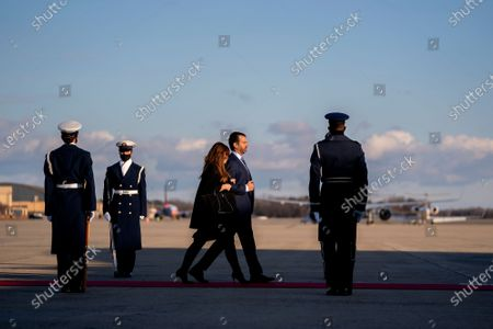 First son Donald Trump Jr., second from right, and his partner Kimberly Guilfoyle walk to board Air Force One during a farewell ceremony at Joint Base Andrews, Maryland, U.S.,. Trump departs Washington with Americans more politically divided and more likely to be out of work than when he arrived, while awaiting trial for his second impeachment - an ignominious end to one of the most turbulent presidencies in American history.