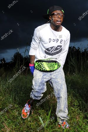 Image taken on 8 Aug 2013. Lil Wayne in the weeds. Dwayne Michael Carter, Jr.