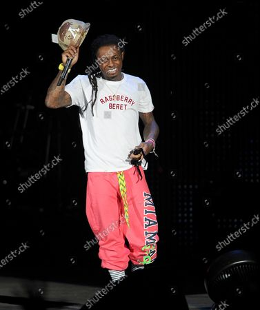 Stock Photo of Image taken on 02 Aug 2011. Rapper Lil Wayne performs during the I Am Still Music tour at the Cruzan Amphitheatre.
