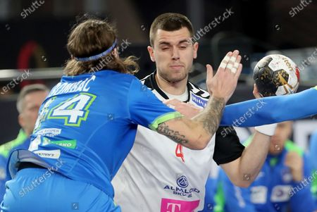 Stock Photo of Martin Velkovski (R) of North Macedonia in action against Dean Bombac (L) of Slovenia during the match between North Macedonia and Slovenia at the 27th Men's Handball World Championship in Cairo, Egypt, 20 January 2021.