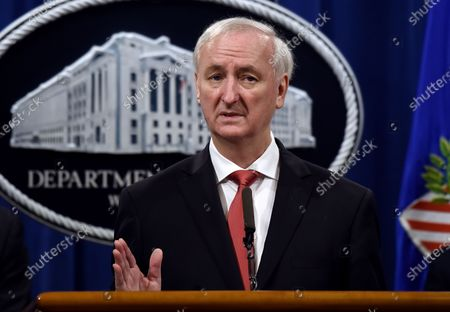 Then Deputy Attorney General Jeffrey Rosen speaks during a press conference at the Department of Justice in Washington. Acting Attorney General Jeffrey Rosen will resign as President-elect Joe Biden takes the oath of office. The Justice Department says Wednesday that Rosen's resignation goes into effect at noon. Rosen has run the department since former Attorney General William Barr resigned on Dec. 23