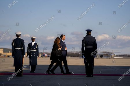 First son Donald Trump Jnr., second from right, and his partner Kimberly Guilfoyle walk to board Air Force One during a farewell ceremony at Joint Base Andrews before the 59th Presidential Inauguration on Wednesday, January 20, 2021 in Washington DC.