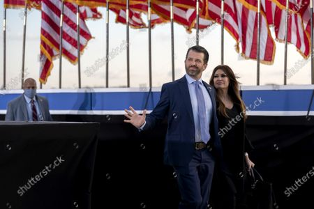 Donald Trump Jnr., executive vice president of development and acquisitions for Trump Organization Inc., left, and his partner Kimberly Guilfoyle, arrive to a farewell ceremony at Joint Base Andrews ahead of the inauguration of President Joe Biden before the 59th Presidential Inauguration on Wednesday, January 20, 2021 in Washington DC.