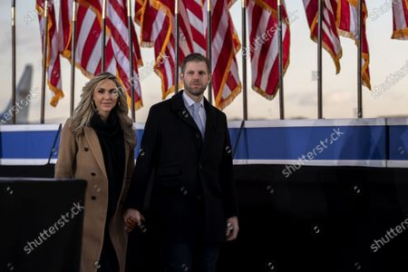 Eric Trump, executive vice president of Trump Organization Inc., right, and his wife Lara Yunaska Trump, arrive to a farewell ceremony at Joint Base Andrews ahead of the inauguration of President Joe Biden before the 59th Presidential Inauguration on Wednesday, January 20, 2021 in Washington DC.