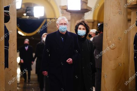 Senate Majority Leader Mitch McConnell and former Secretary of Transportation Elaine Chao (R) arrive in the Crypt of the US Capitol for President-elect Joe Biden's inauguration ceremony to be the 46th President of the United States in Washington, DC, USA, 20 January 2021. Biden won the 03 November 2020 election to become the 46th President of the United States of America.