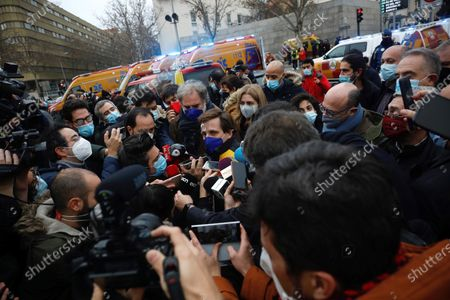 Madrid's Mayor, Jose Luis Rodriguez-Almeida (C), speaks to the media at Puerta de Toledo in Madrid, Spain, 20 January 2021, after a strong gas explosion caused the collapse of part of a building close to the Virgin of La Paloma church. At least three people died due to the explosion, according to reports.