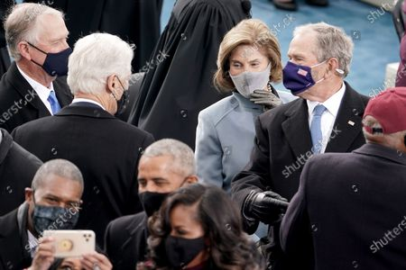 Former vice president Dan Quayle and former president Bill Clinton speak to former president George W. Bush prior to the inauguration of Joe Biden as US President in Washington, DC, USA, 20 January 2021. Biden won the 03 November 2020 election to become the 46th President of the United States of America.