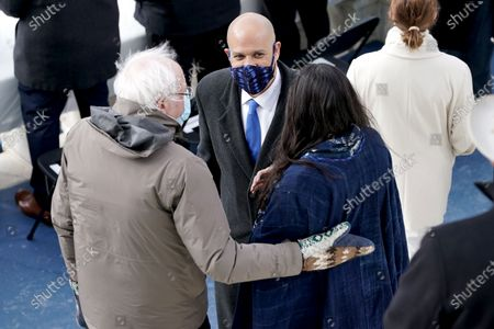 Sen. Cory Booker (D-N.J.) and Rosario Dawson speak to Sen. Bernie Sanders (I-Vt.) prior to the inauguration of Joe Biden as US President in Washington, DC, USA, 20 January 2021. Biden won the 03 November 2020 election to become the 46th President of the United States of America.